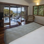 Sandpiper Suite bedroom and deck with Coral Sea view