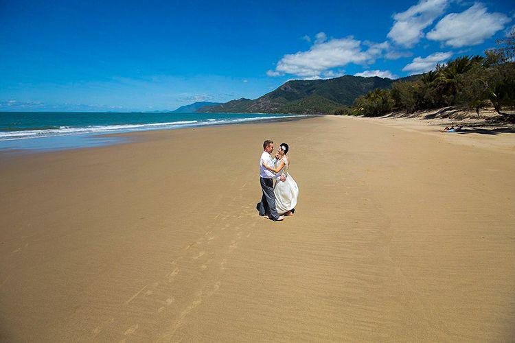 Wedding couple on beach at Thala Beach Nature Reserve